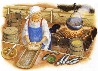 Mujer cocinando pan.